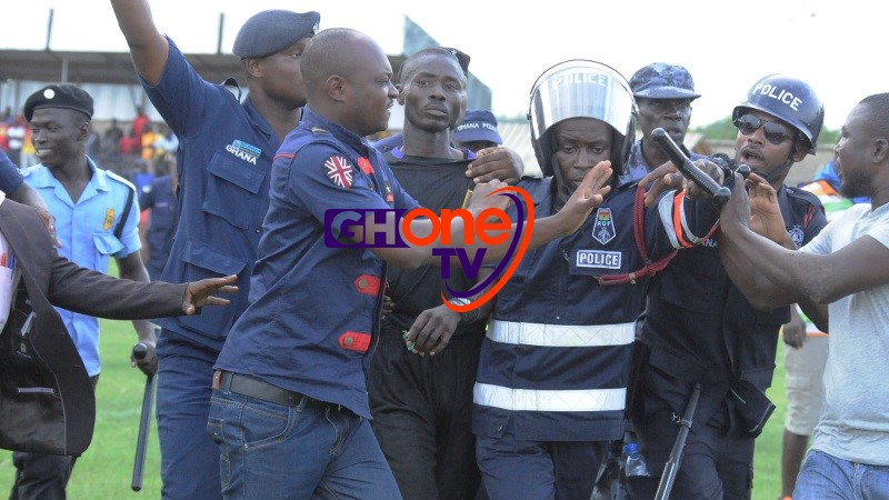 Referee Charles ulu being heavily guarded by the Ghana Police at half time of Edubiase vs Kotoko game