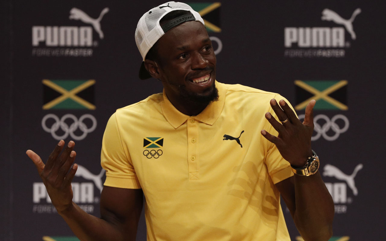 Usain Bolt speaks during a Jamaican Olympic Association and Puma press conference at the Cidade Das Artes in Rio de Janeiro on August 8, 2016.  / AFP PHOTO / Adrian DENNIS