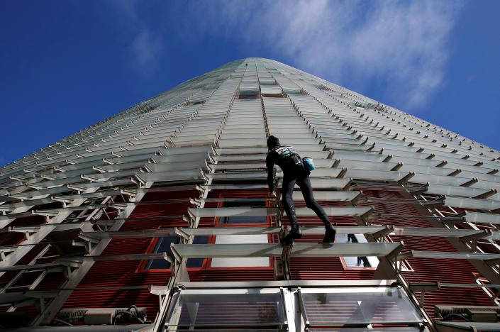 [Photos] French 'Spiderman' climbs Barcelona skyscraper harness-free